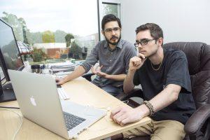 Student intern Josh Baylor working at Mindsense in Blacksburg with CEO and alum Alex Obenauer.