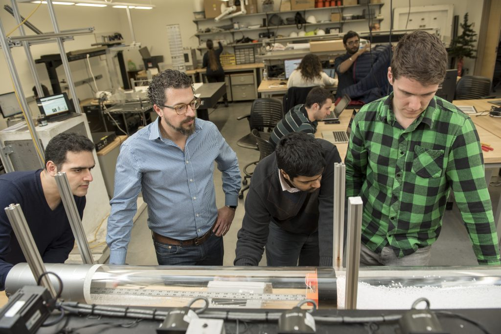 Mechanical Engineering Assistant Professor Pablo Tarazaga with graduate students