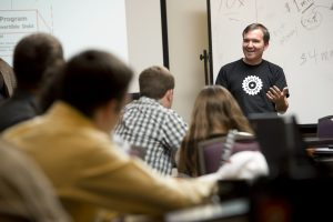 Professor Marc Junkunc teaching students in class on entrepreneurship at the Innovate living-learning community. Guest speakers Jennifer O'Daniel, CIT GAP Funds and Bob Summers (black shirt), serial entrepreneur and founder of TechPad.